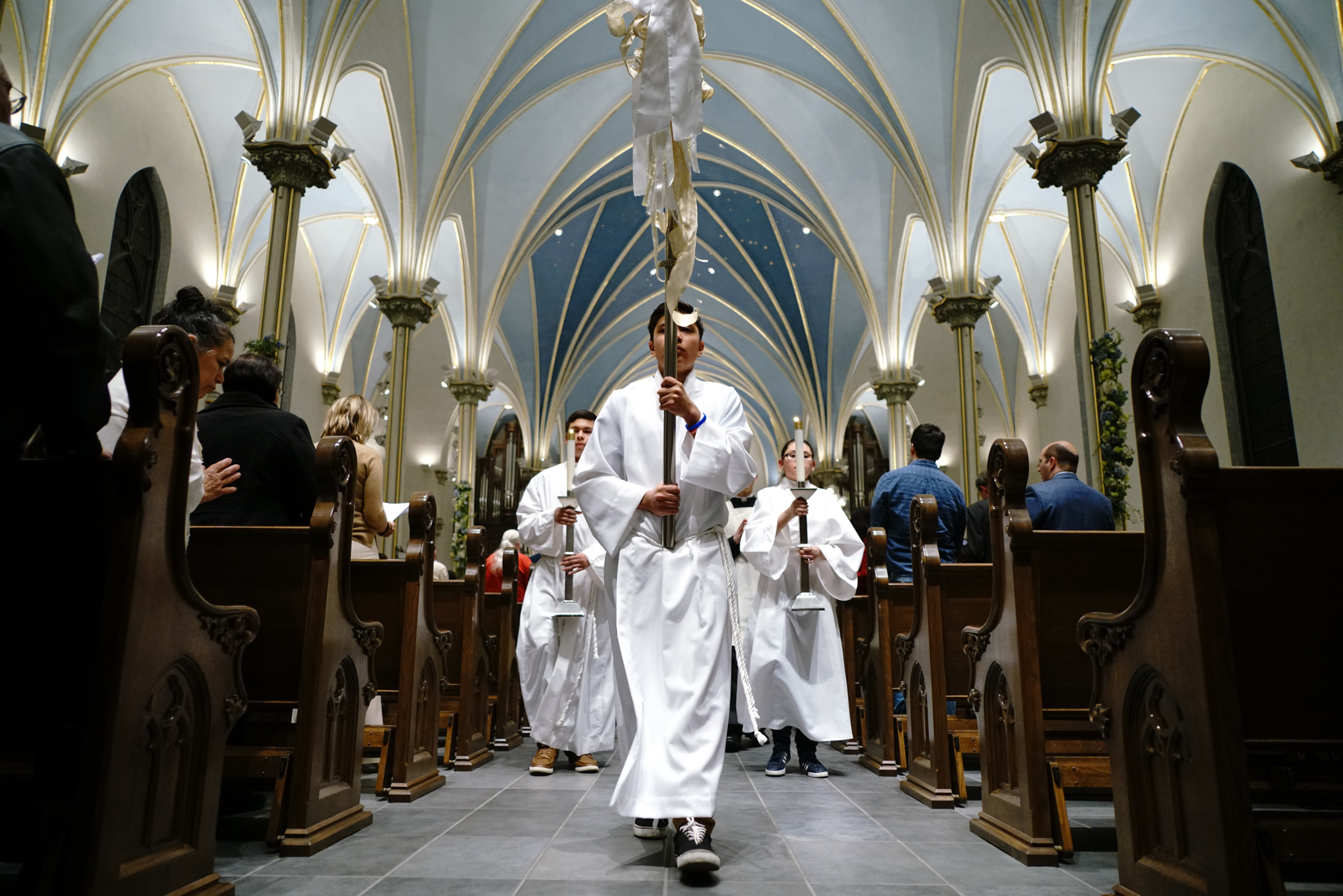 Altar servers recess out of the Cathedral after the Easter Vigil Mass.