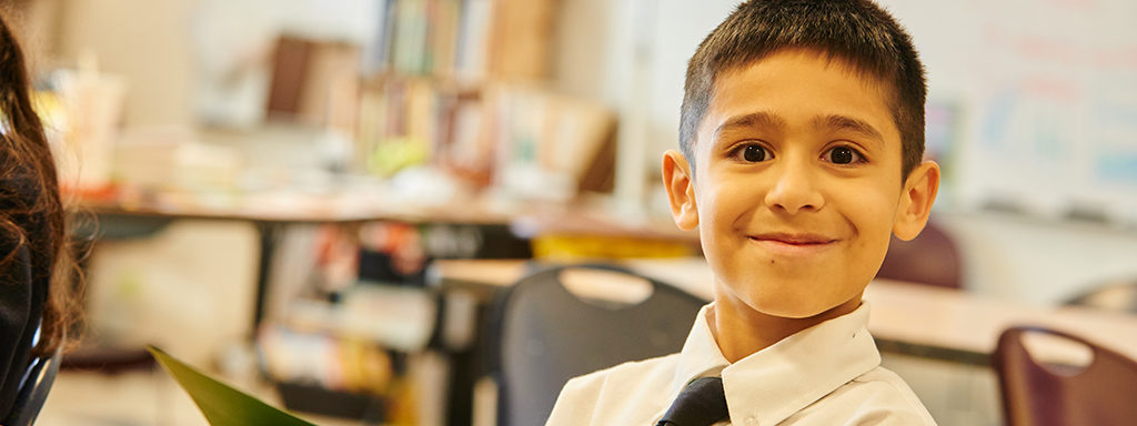 A student smiles at Corpus Christi Catholic School in Holland.