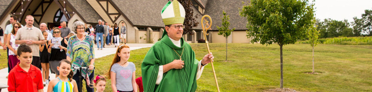 Bishop Walkowiak leads procession following blessing and dedication at St. Sebastian, Byron Center