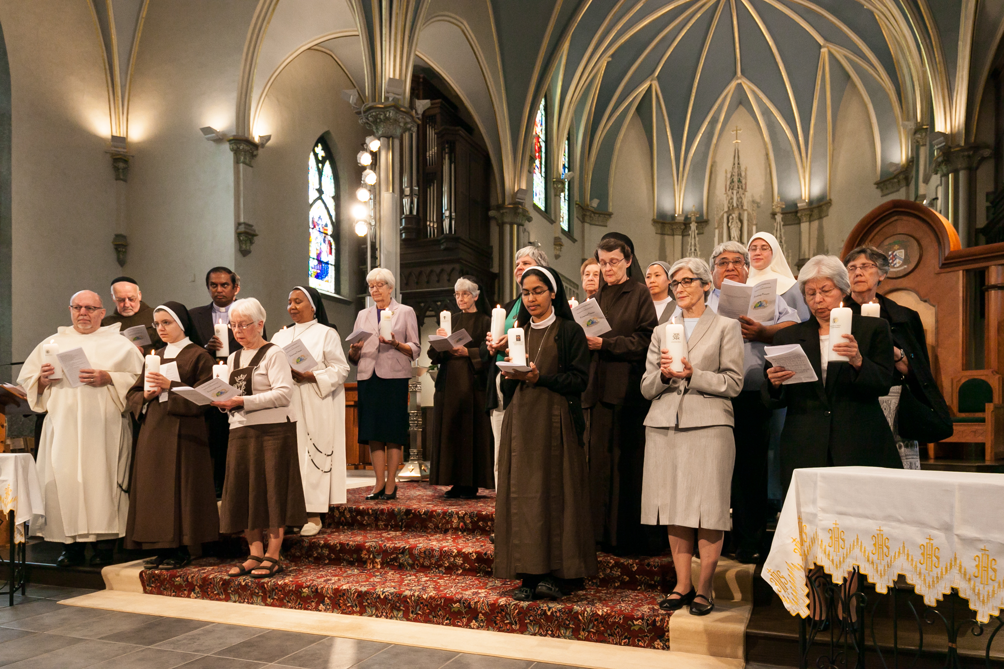 pirests and sisters stand on the altar of the cathedral of saint andrew during a blessing during the mass for consecrated religious life in sept. 2015