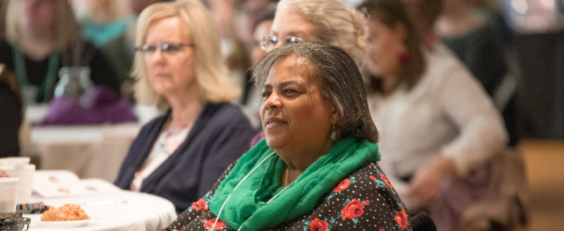 a woman listens to the speaker at the annual diocesan women's conference at assumption of the blessed virgin mary parish in belmont, michigan