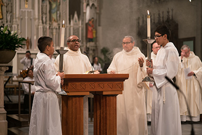Deacon Gutierrez and Deacon Zapata during Mass at the Cathedral of Saint Andrew.