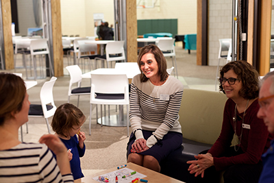 St. Robert School Principal Liz Peters talks with a family
