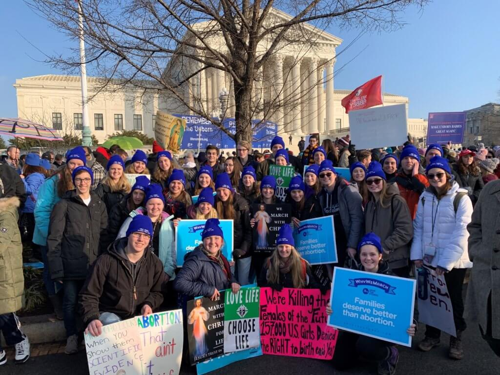 Youth and leaders from Holy Family Parish in Caledonia in front of the Supreme Court building at March for Life 2019