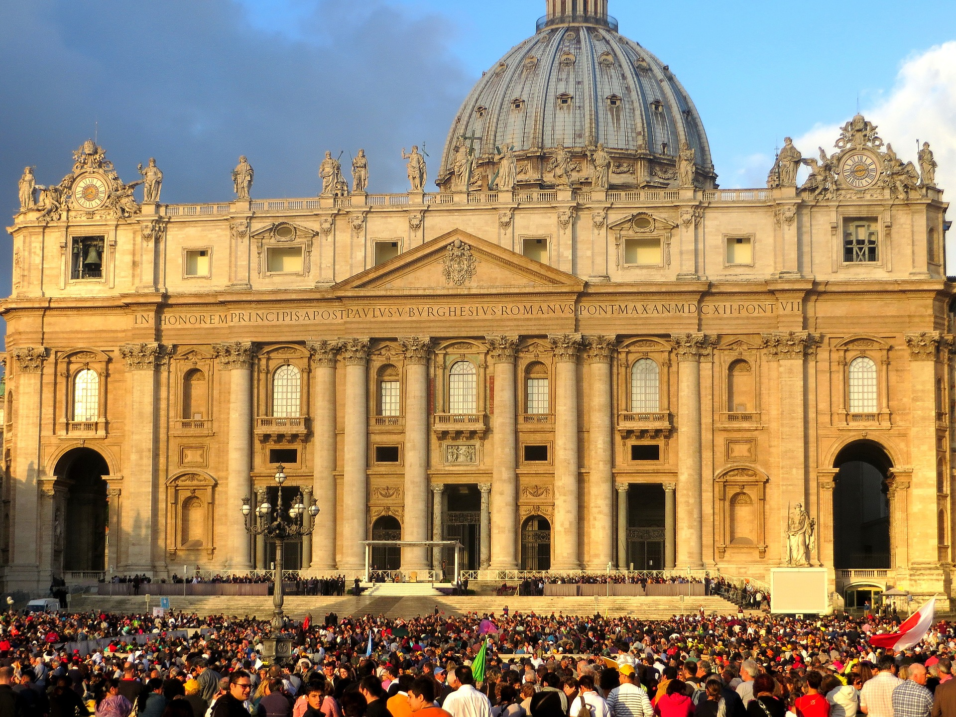 photos of st. peters basilica in rome at sunset