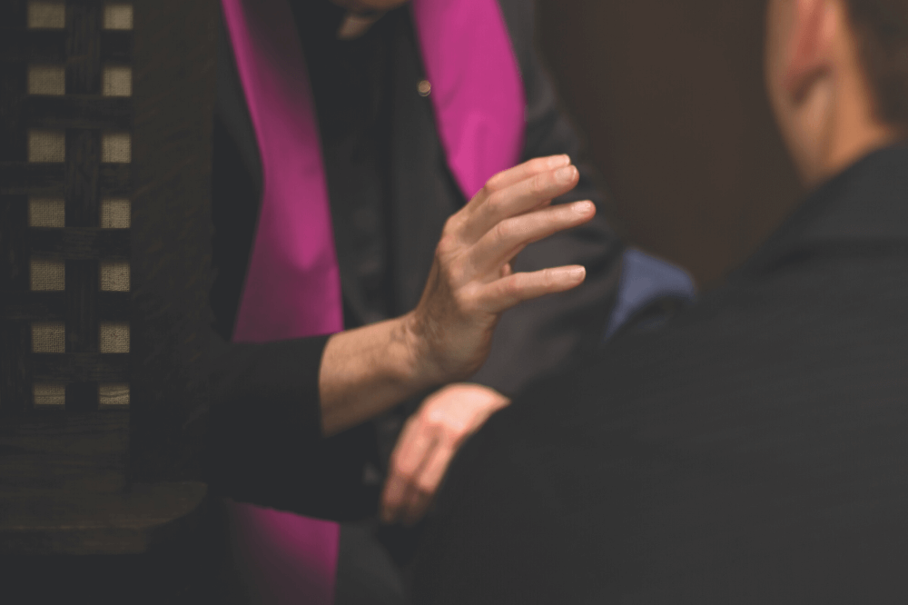 Image of a priest giving absolution during confession