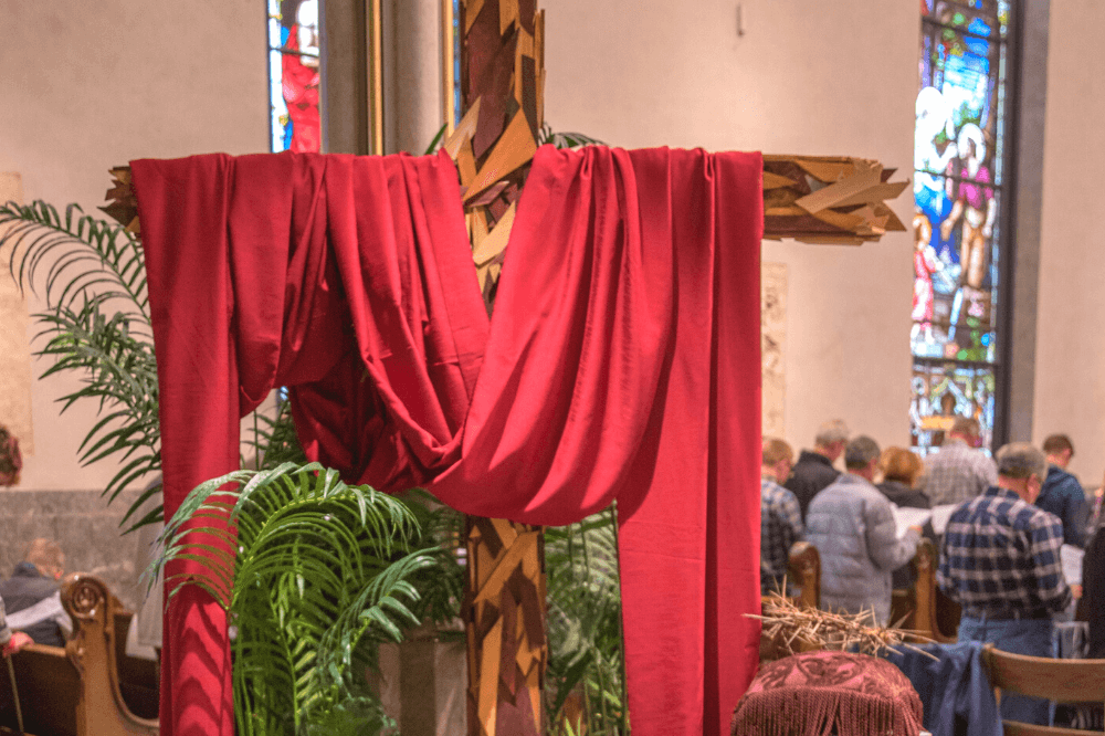 Image of wooden cross draped in red from Palm Sunday 2019, Cathedral of Saint Andrew, by Jaymie Perry
