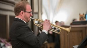 Trumpeter plays during 2017 Palm Sunday Mass at the Cathedral by Jaymie Perry