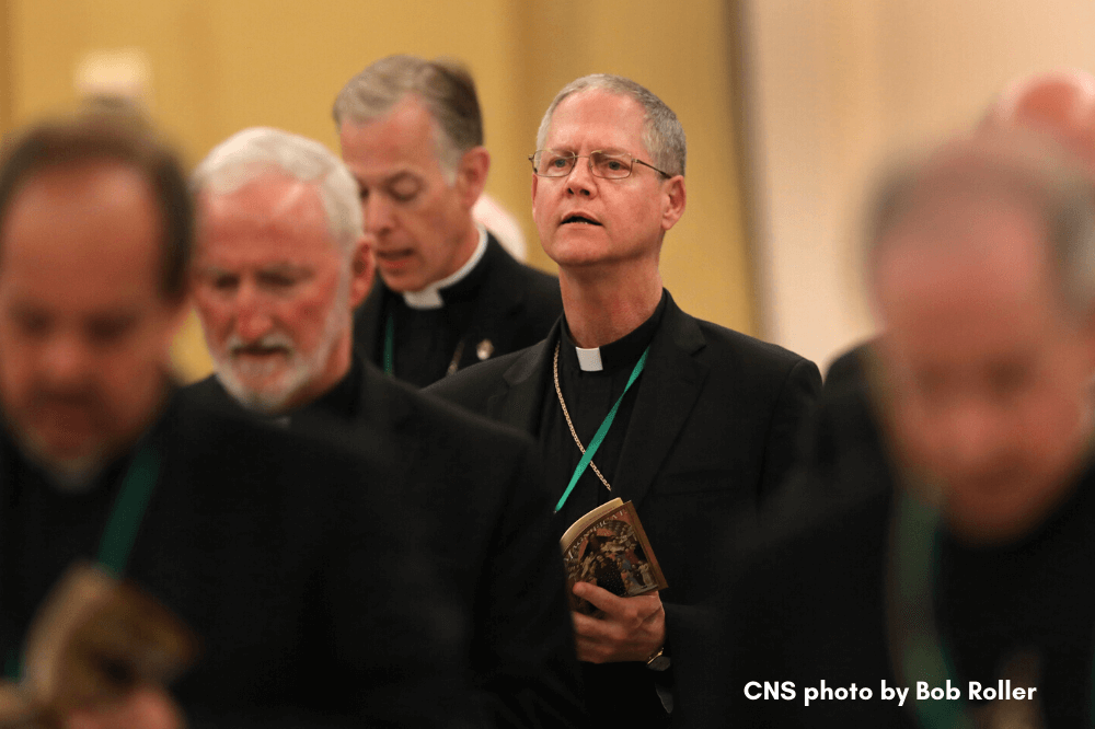 CNS photo by Bob Roller, Archbishop Paul D. Etienne of Seattle attends afternoon prayer, spring assembly 2019
