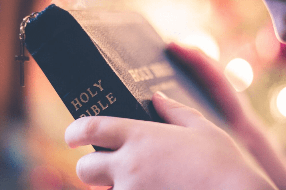 Image of hands holding a Holy Bible