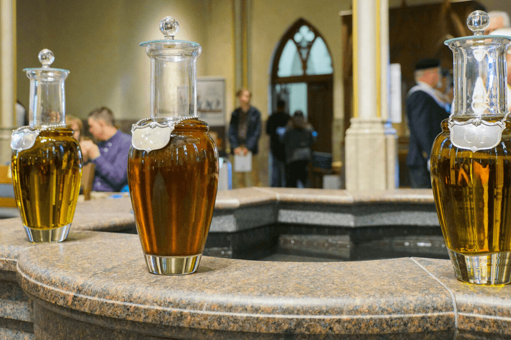 holy oils in jars at chrism Mass, Cathedral of Saint Andrew, 2019 by Eric Tank