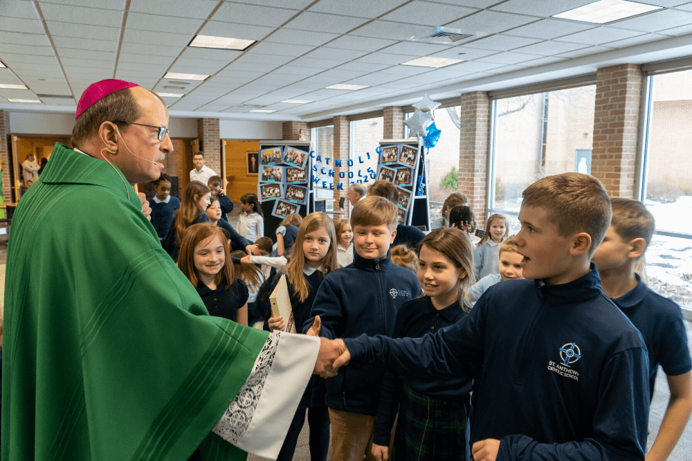 Bishop Walkowiak greets students following Mass at St. Anthony of Padua, Jan. 2020